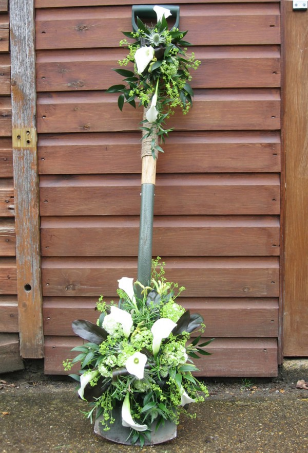 Funeral flowers gardeners spade floral tribute