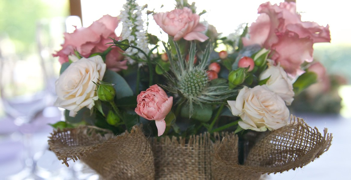 Floral arrangement in hessian container