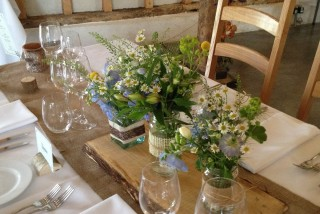 Simple blue and white floral table displays - Driftwood Flowers