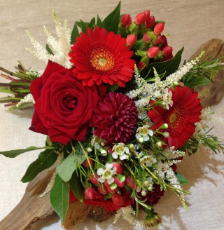 Red rose and Gerbera bridal spray from Driftwood Flowers