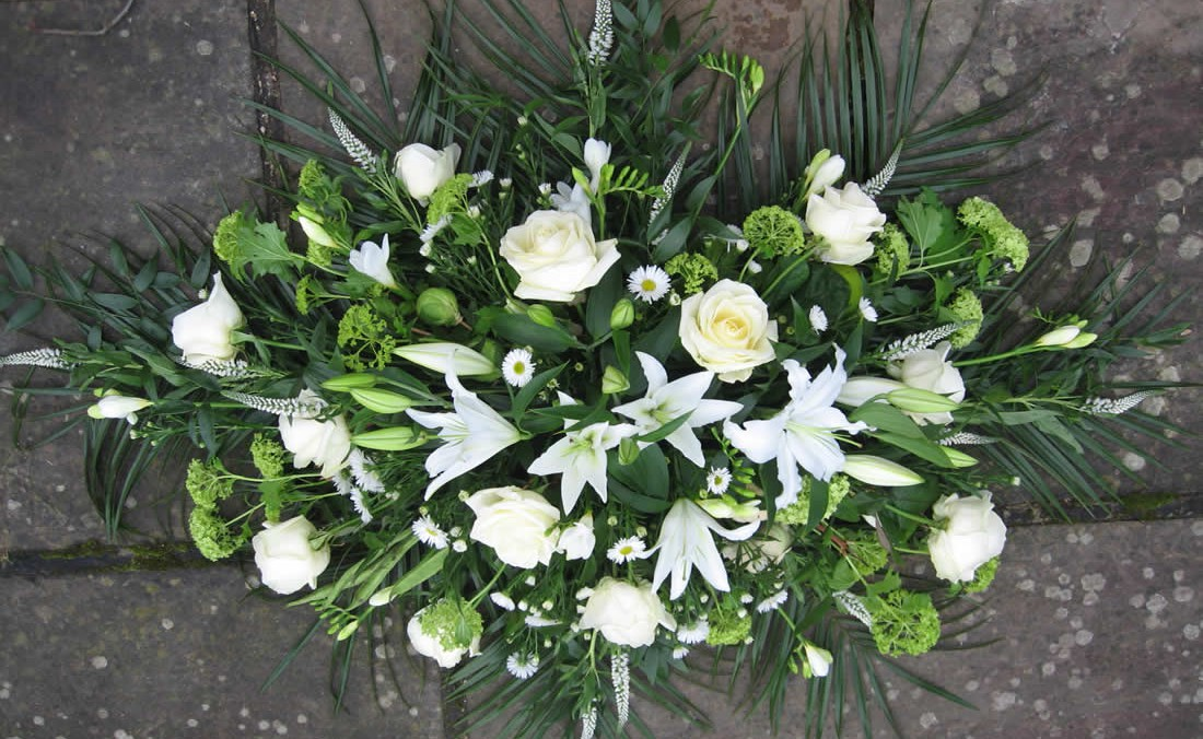 Driftwood Flowers - funeral flowers - white rose and lily spray