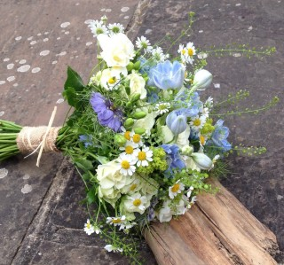 White rose and blue flower bouquet