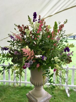 Driftwood Flowers pedestal floral display in reception Marquee