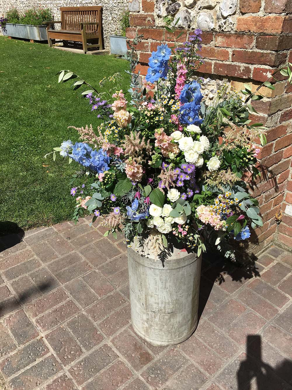 Reception floral decoration from Driftwood Wedding Flowers, Chichester