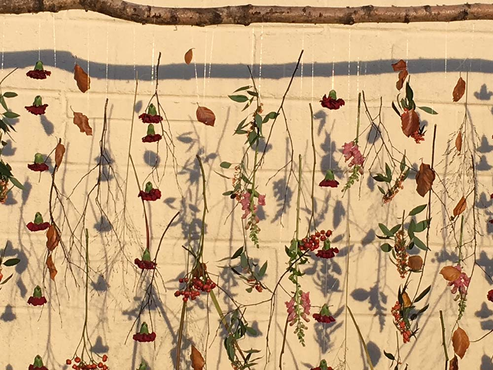 Floral wall hanging decoration from Driftwood Wedding Flowers, Chichester