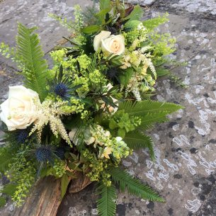 Green & white floral decoration from Driftwood Wedding Flowers, Chichester