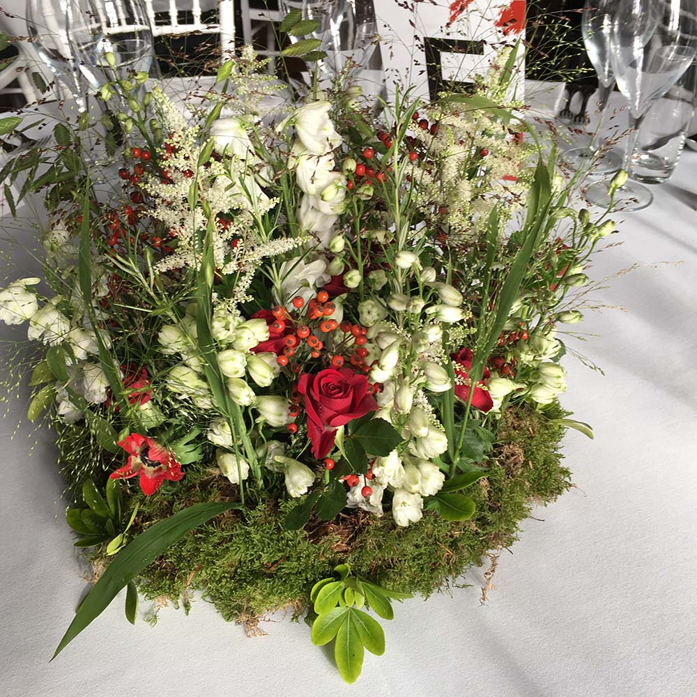 Wedding reception table centrepiece from Driftwood Wedding Flowers, Chichester