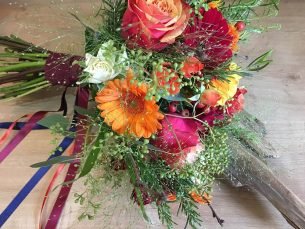 Vibrant orange & Pink hand tied bridal bouquet from Driftwood Flowers Chichester