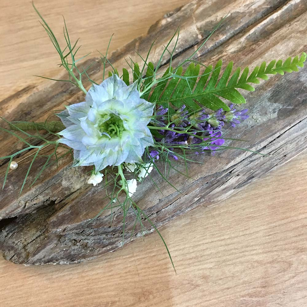 Blue wedding buttonhole from Driftwood Wedding Flowers, Chichester