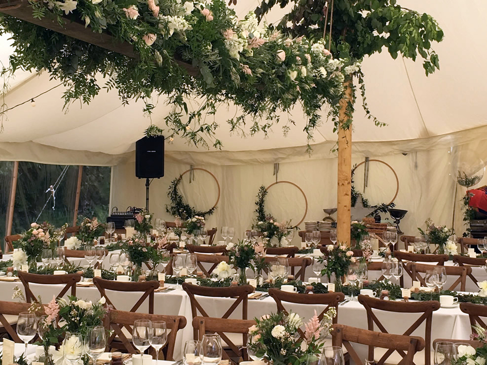 Wedding Marquee suspended floral decorations from Driftwood Flowers, the wedding flowers specialist Chichester