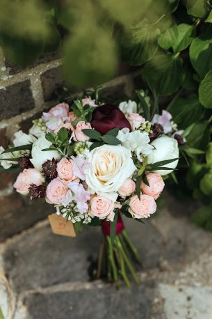 Baby pink and red roses in a bridal bouquet - Driftwood Flowers, Lavant, Chichester