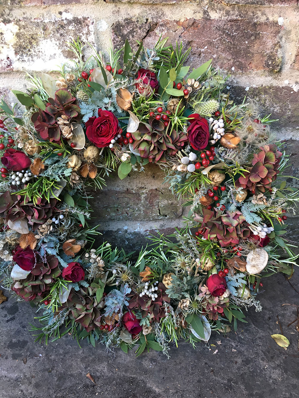 Red rose funeral wreath - funeral flowers from Driftwood FLowers Lavant near Chichester